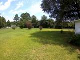 <h5>Back Yard</h5><p>Nice large 3/4 acre lot</p>